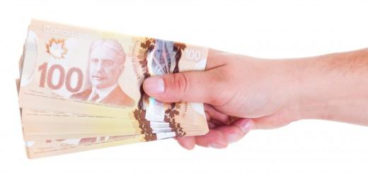 o-CANADIAN-DOLLARS-HAND-facebook